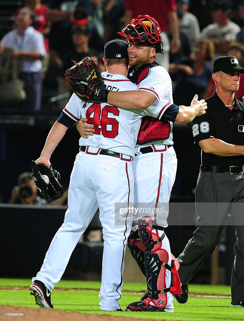 <a gi-track='captionPersonalityLinkClicked' href=/galleries/search?phrase=Craig+Kimbrel&family=editorial&specificpeople=6795784 ng-click='$event.stopPropagation()'>Craig Kimbrel</a> #46 and <a gi-track='captionPersonalityLinkClicked' href=/galleries/search?phrase=Brian+McCann&family=editorial&specificpeople=593065 ng-click='$event.stopPropagation()'>Brian McCann</a> #16 of the Atlanta Braves celebrate after the game against the Cleveland Indians at Turner Field on August 29, 2013 in Atlanta, Georgia.