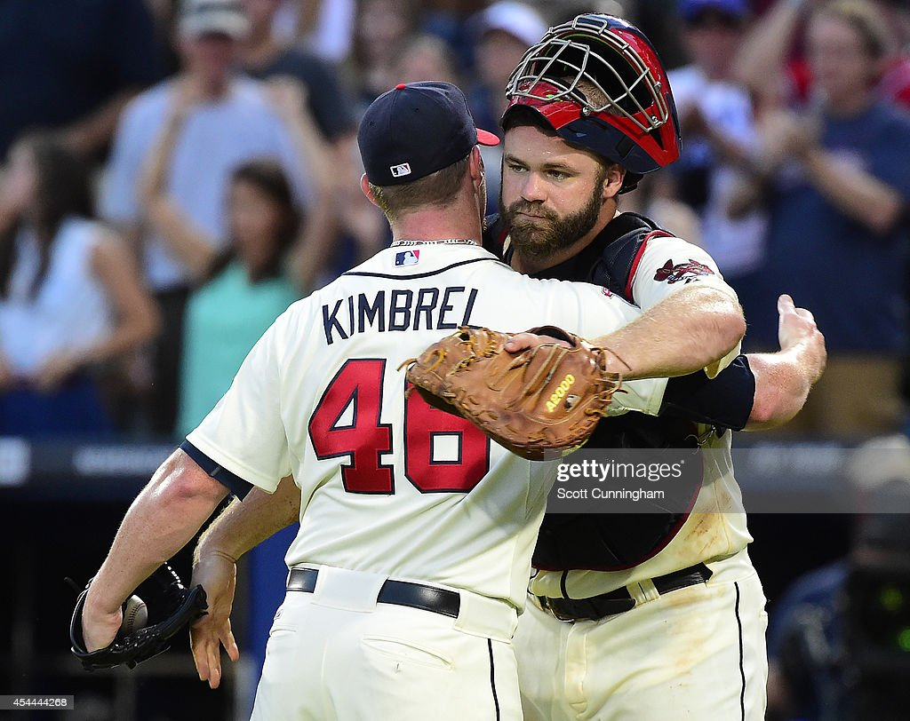 <a gi-track='captionPersonalityLinkClicked' href=/galleries/search?phrase=Craig+Kimbrel&family=editorial&specificpeople=6795784 ng-click='$event.stopPropagation()'>Craig Kimbrel</a> #46 and <a gi-track='captionPersonalityLinkClicked' href=/galleries/search?phrase=Evan+Gattis&family=editorial&specificpeople=8977937 ng-click='$event.stopPropagation()'>Evan Gattis</a> #24 of the Atlanta Braves celebrate after the game against the Miami Marlins at Turner Field on August 31, 2014 in Atlanta, Georgia.