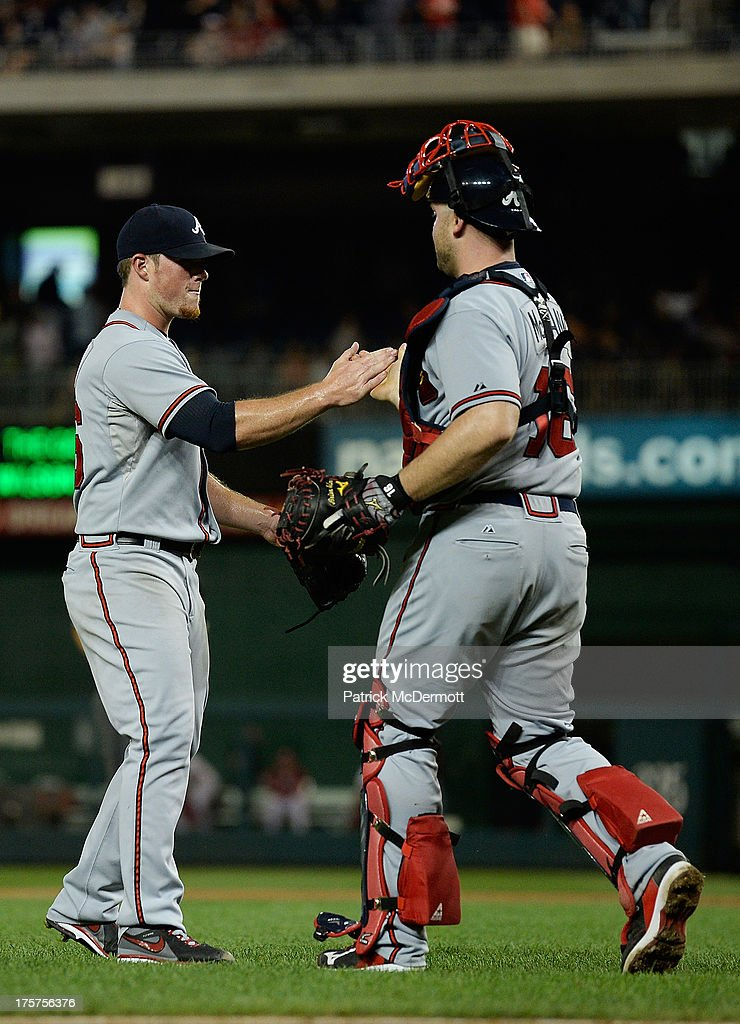 <a gi-track='captionPersonalityLinkClicked' href=/galleries/search?phrase=Craig+Kimbrel&family=editorial&specificpeople=6795784 ng-click='$event.stopPropagation()'>Craig Kimbrel</a> #46 celebrates with <a gi-track='captionPersonalityLinkClicked' href=/galleries/search?phrase=Brian+McCann+-+Baseball+Player&family=editorial&specificpeople=593065 ng-click='$event.stopPropagation()'>Brian McCann</a> #16 of the Atlanta Braves after the Braves defeated the Washington Nationals 6-3 during a game at Nationals Park on August 7, 2013 in Washington, DC.