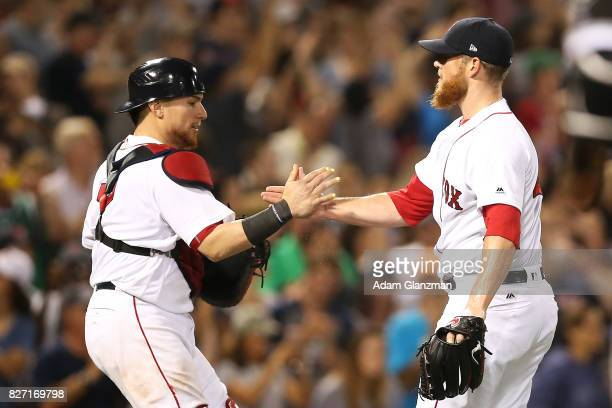 Craig Kimbrel embraces Christian Vazquez of the Boston Red Sox after a victory over the Chicago White Sox at Fenway Park on August 5 2017 in Boston...