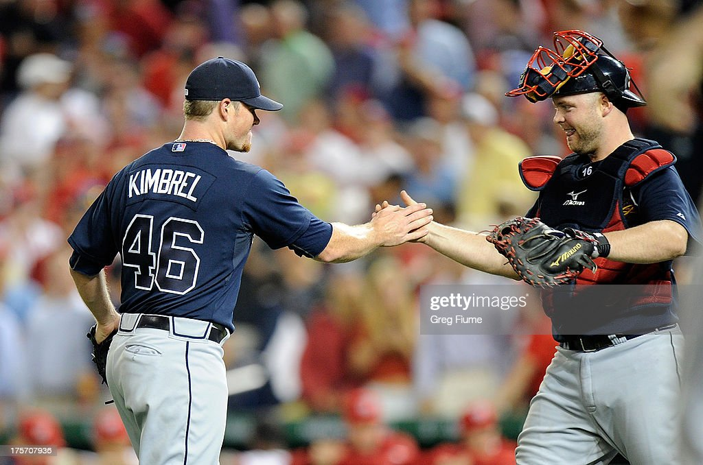 <a gi-track='captionPersonalityLinkClicked' href=/galleries/search?phrase=Craig+Kimbrel&family=editorial&specificpeople=6795784 ng-click='$event.stopPropagation()'>Craig Kimbrel</a> #46 of the Atlanta Braves celebrates with <a gi-track='captionPersonalityLinkClicked' href=/galleries/search?phrase=Brian+McCann+-+Baseball+Player&family=editorial&specificpeople=593065 ng-click='$event.stopPropagation()'>Brian McCann</a> #16 after a 2-1 victory against the Washington Nationals at Nationals Park on August 6, 2013 in Washington, DC.