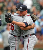 Craig Kimbrel of the Atlanta Braves gets a hug from Dan Uggla after a win against the Chicago Cubs at Wrigley Field on September 20 2013 in Chicago...