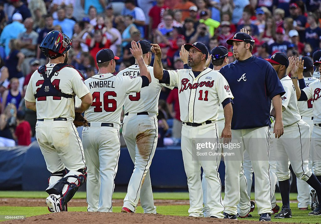 <a gi-track='captionPersonalityLinkClicked' href=/galleries/search?phrase=Craig+Kimbrel&family=editorial&specificpeople=6795784 ng-click='$event.stopPropagation()'>Craig Kimbrel</a> #46 of the Atlanta Braves is congratulated by <a gi-track='captionPersonalityLinkClicked' href=/galleries/search?phrase=Gerald+Laird&family=editorial&specificpeople=228949 ng-click='$event.stopPropagation()'>Gerald Laird</a> #11 after the game against the Miami Marlins at Turner Field on August 31, 2014 in Atlanta, Georgia.