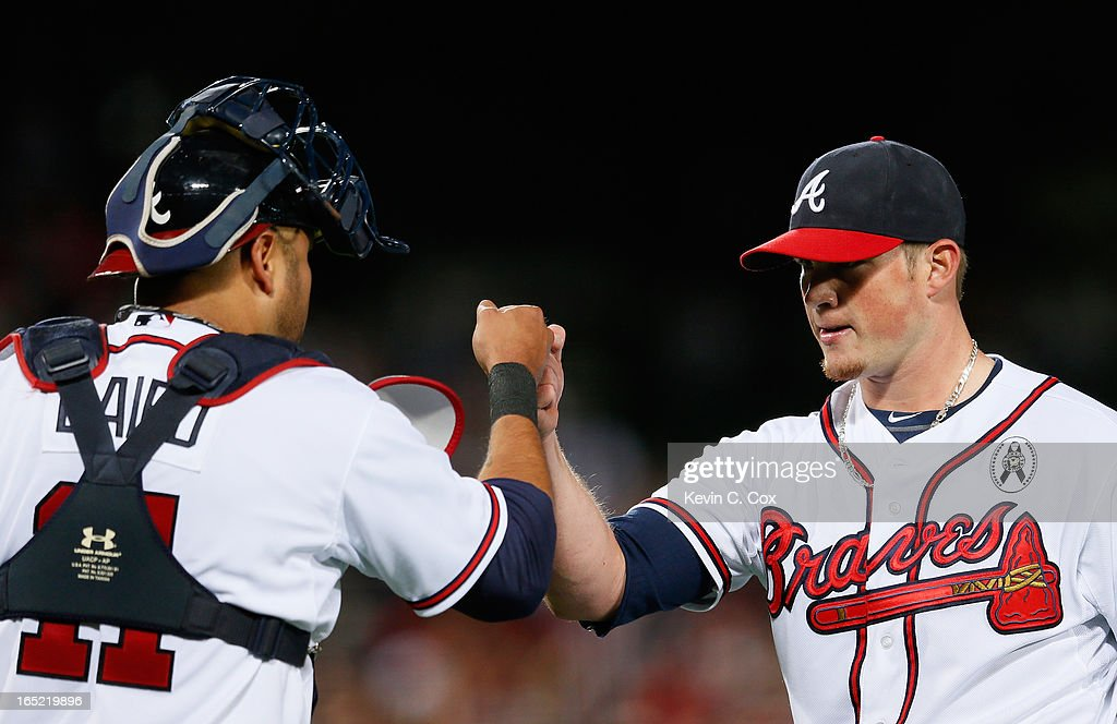 <a gi-track='captionPersonalityLinkClicked' href=/galleries/search?phrase=Craig+Kimbrel&family=editorial&specificpeople=6795784 ng-click='$event.stopPropagation()'>Craig Kimbrel</a> #46 of the Atlanta Braves reacts with <a gi-track='captionPersonalityLinkClicked' href=/galleries/search?phrase=Gerald+Laird&family=editorial&specificpeople=228949 ng-click='$event.stopPropagation()'>Gerald Laird</a> #11 after their 7-5 win over the Philadelphia Phillies during Opening Day at Turner Field on April 1, 2013 in Atlanta, Georgia.