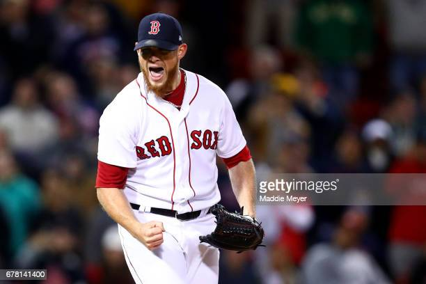 Craig Kimbrel of the Boston Red Sox celebrates after striking out Manny Machado of the Baltimore Orioles to defeat the Orioles 42 at Fenway Park on...