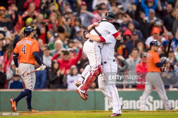 Craig Kimbrel of the Boston Red Sox reacts with Christian Vazquez as he records the final out to clinch the American League East Division against the...