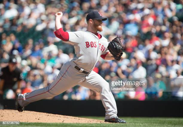 Craig Kimbrel of the Boston Red Sox throws the final pitch in the ninth inning to strike out Carlos Ruiz of the Seattle Mariners at Safeco Field on...