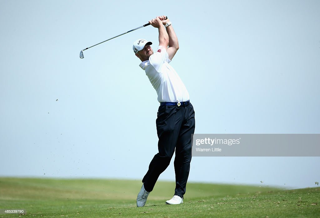 <a gi-track='captionPersonalityLinkClicked' href=/galleries/search?phrase=Craig+Lee&family=editorial&specificpeople=2959657 ng-click='$event.stopPropagation()'>Craig Lee</a> of Scotland plays his second shot into the 18th green during the second round of the Africa Open at East London Golf Club on March 6, 2015 in East London, South Africa.