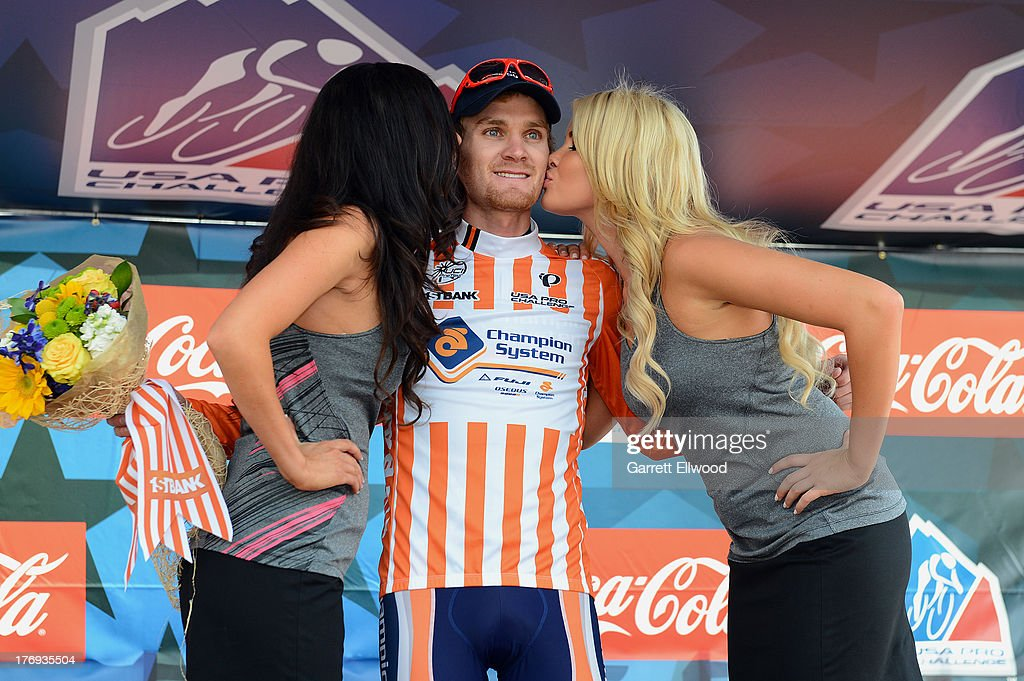 Craig Lewis #75 of the United States riding for Champion Systems receives kisses from the podium girls after receiving the 1st. Bank Most Courageous Rider Jersey on Stage One of the USA Pro Cycling Challenge on August 19, 2013 in Aspen, Colorado.