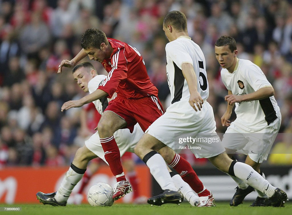 Craig Lindfield of Liverpool beats Sam Hewson and James Chester of Manchester United during the FA Youth Cup Final 1st Leg match between Liverpool...