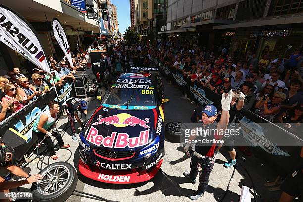 Craig Lowndes and Jamie Whincup of Red Bull Racing Australia participate with fans in a pit stop challenge in Rundle Mall ahead of the V8 Supercars...