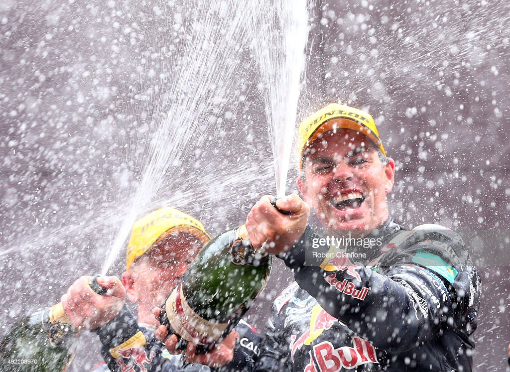 Craig Lowndes and Steven Richards of the #888 Red Bull Racing Australia Holden celebrate on the podium after winning the Bathurst 1000, which is race 25 of the V8 Supercars Championship at Mount Panorama on October 11, 2015 in Bathurst, Australia.