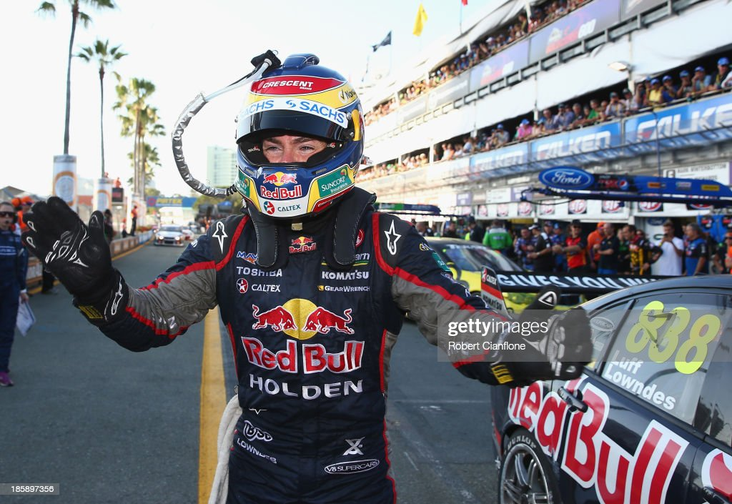 <a gi-track='captionPersonalityLinkClicked' href=/galleries/search?phrase=Craig+Lowndes&family=editorial&specificpeople=213462 ng-click='$event.stopPropagation()'>Craig Lowndes</a> driver of the #888 Red Bull Racing Australia Holden celebrates after he won race 30 for the Gold Coast 600, which is round 12 of the V8 Supercars Championship Series at the Surfers Paradise Street Circuit on October 26, 2013 on the Gold Coast, Australia.