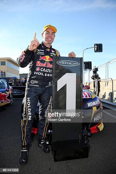Craig Lowndes driver of the Red Bull Racing Australia Holden celebrates after winning race 6 for the Tasmania 400 which is round two of the V8 Super...