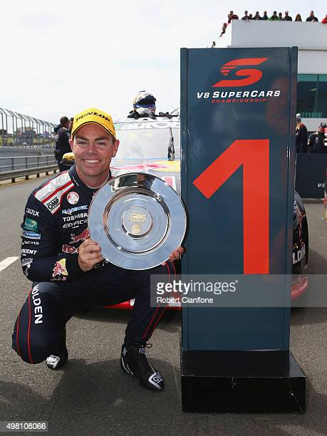Craig Lowndes driver of the Red Bull Racing Australia Holden celebrates after winning Race 31 for the Phillip Island SuperSprint which is part of the...