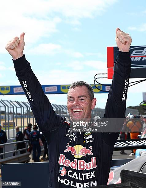 Craig Lowndes driver of the Red Bull Racing Australia Holden celebrates after winning Race 33 for the Phillip Island SuperSprint which is part of the...