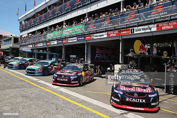 Craig Lowndes driver of the Red Bull Racing Australia Holden and Mark Winterbottom driver of the Pepsi Max Crew Ford sit in pit lane prior to...