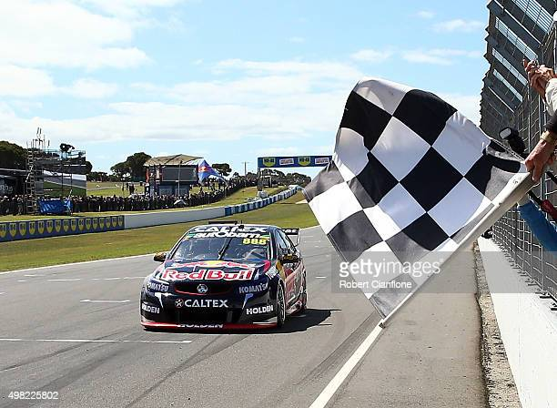 Craig Lowndes driver of the Red Bull Racing Australia Holden crosses the line to win Race 33 for the Phillip Island SuperSprint which is part of the...