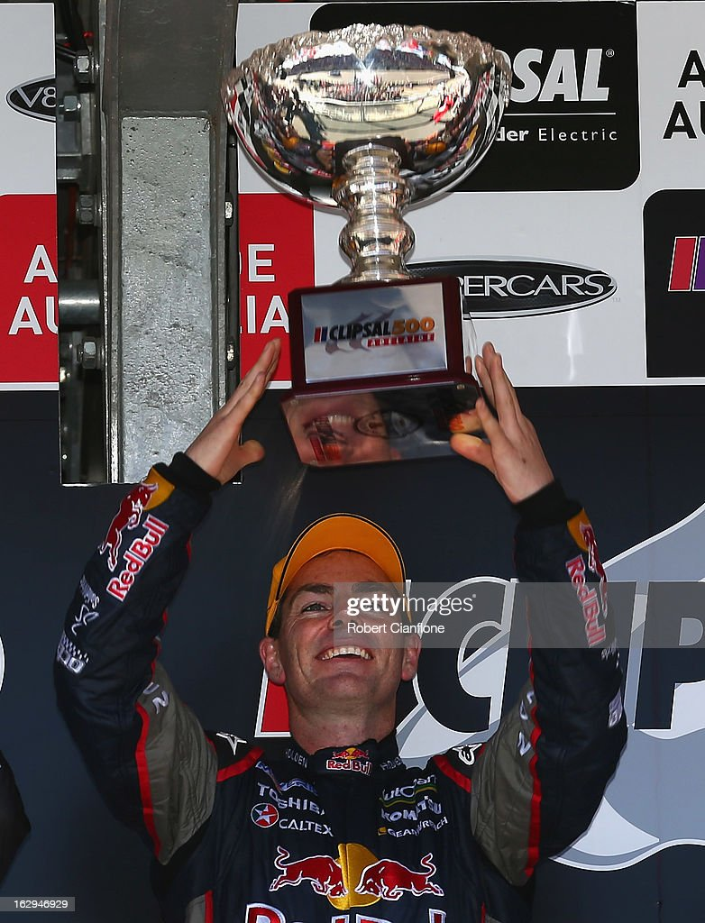 <a gi-track='captionPersonalityLinkClicked' href=/galleries/search?phrase=Craig+Lowndes&family=editorial&specificpeople=213462 ng-click='$event.stopPropagation()'>Craig Lowndes</a> driver of the #888 Red Bull Racing Australia Holden hold aloft the winners trophy after winning race one of the Clipsal 500, which is round one of the V8 Supercar Championship Series, at the Adelaide Street Circuit on March 2, 2013 in Adelaide, Australia.