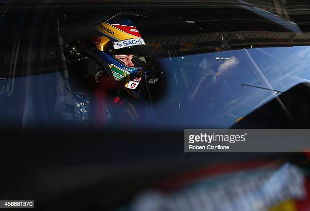 Craig Lowndes driver of the Red Bull Racing Australia Holden sits in his car prior to practice for the Bathurst 1000 which is round 11 of the V8...