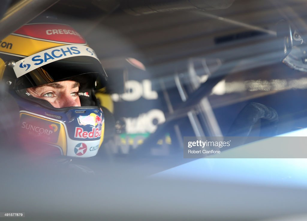 Craig Lowndes driver of the Red Bull Racing Australia Holden sits in his car prior to qualifying for the Perth 400 which is round five of the V8...