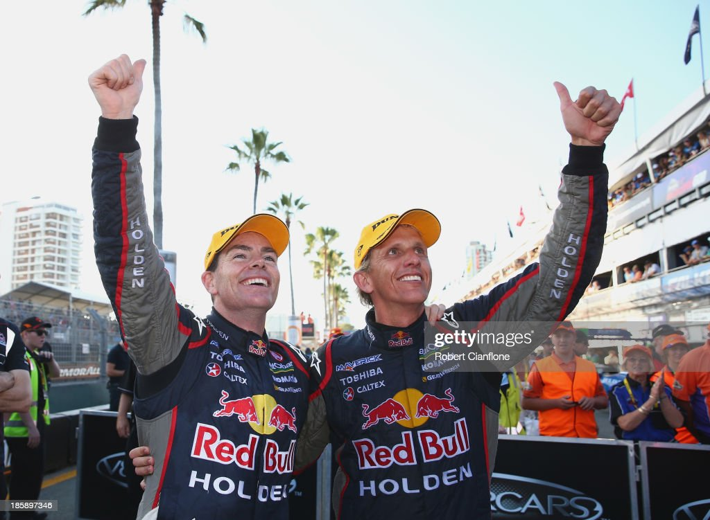 <a gi-track='captionPersonalityLinkClicked' href=/galleries/search?phrase=Craig+Lowndes&family=editorial&specificpeople=213462 ng-click='$event.stopPropagation()'>Craig Lowndes</a> driver of the #888 Red Bull Racing Australia Holden celebrates with co driver <a gi-track='captionPersonalityLinkClicked' href=/galleries/search?phrase=Warren+Luff&family=editorial&specificpeople=167258 ng-click='$event.stopPropagation()'>Warren Luff</a> after they won after race 30 for the Gold Coast 600, which is round 12 of the V8 Supercars Championship Series at the Surfers Paradise Street Circuit on October 26, 2013 on the Gold Coast, Australia.