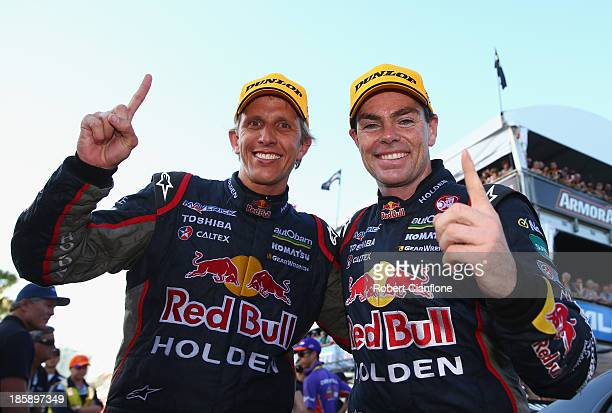 Craig Lowndes driver of the Red Bull Racing Australia Holden celebrates with co driver Warren Luff after they won after race 30 for the Gold Coast...