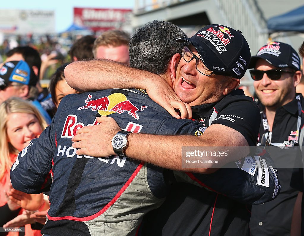 Craig Lowndes driver of the Red Bull Racing Australia Holden celebrates with team principal Roland Dane after winning race 10 and breaking Mark...