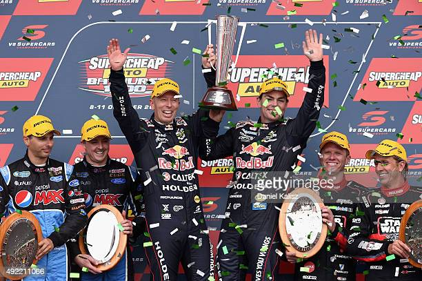 Craig Lowndes driver of the Red Bull Racing Holden VF Commodore and Steven Richards driver of the Red Bull Racing Holden VF Commodore celebrate on...