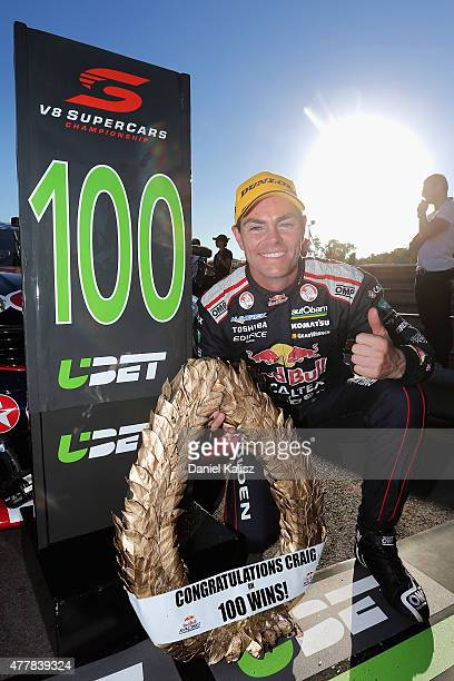 Craig Lowndes driver of the Red Bull Racing Holden VF Commodore reacts after winning his 100th race after race 14 for the V8 Supercars Triple Crown...