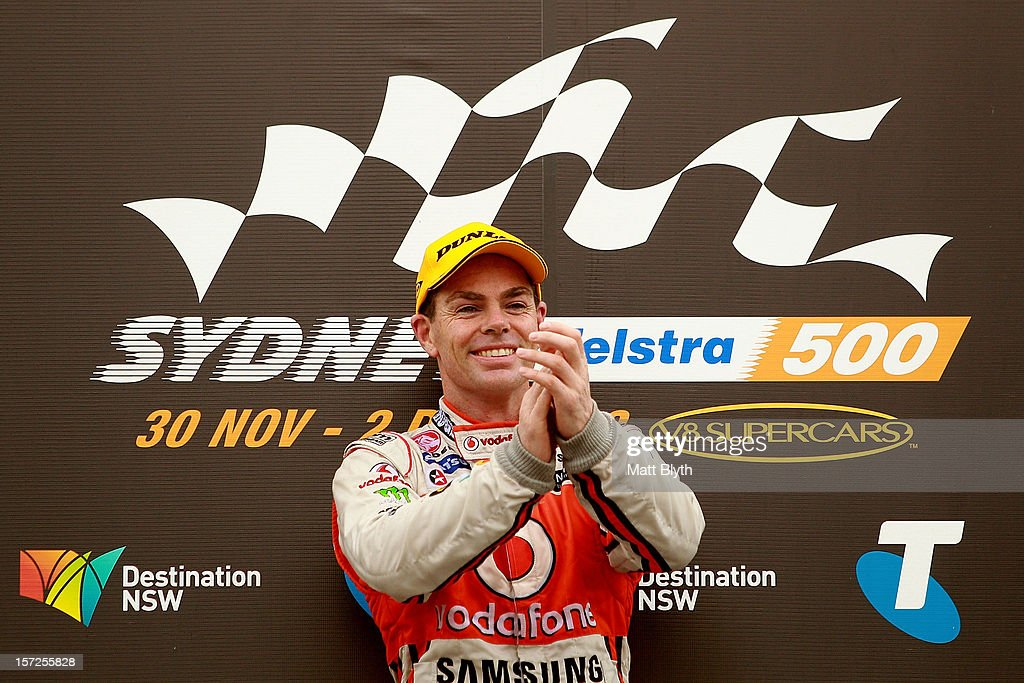 <a gi-track='captionPersonalityLinkClicked' href=/galleries/search?phrase=Craig+Lowndes&family=editorial&specificpeople=213462 ng-click='$event.stopPropagation()'>Craig Lowndes</a> driver of the #888 Team Vodafone Holden celebrates after winning race 29 during the Sydney 500, which is round 15 of the V8 Supercars Championship Series at Sydney Olympic Park Street Circuit on December 1, 2012 in Sydney, Australia.