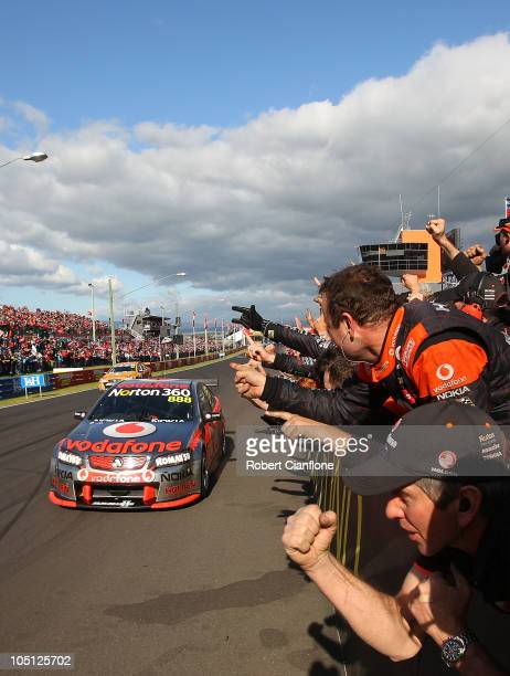 Craig Lowndes driver of the Team Vodafone Holden is congratulated by his team after winning the Bathurst 1000 which is round 10 of the V8 Supercars...