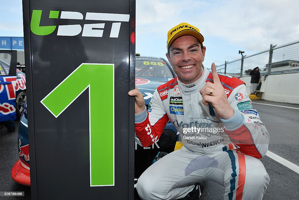 Craig Lowndes driver of the TeamVortex Holden Commodore VF celebrates in parc ferme after winning race 1 for the V8 Supercars Perth SuperSprint at...
