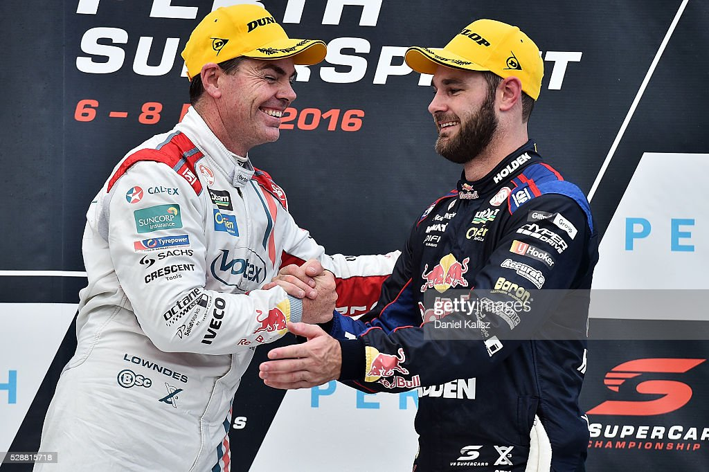 Craig Lowndes driver of the #888 TeamVortex Holden Commodore VF shakes hands with Shane Van Gisbergen driver of the #97 Red Bull Racing Australia Holden Commodore VF after race 1 for the V8 Supercars Perth SuperSprint at Barbagallo Raceway on May 7, 2016 in Perth, Australia.