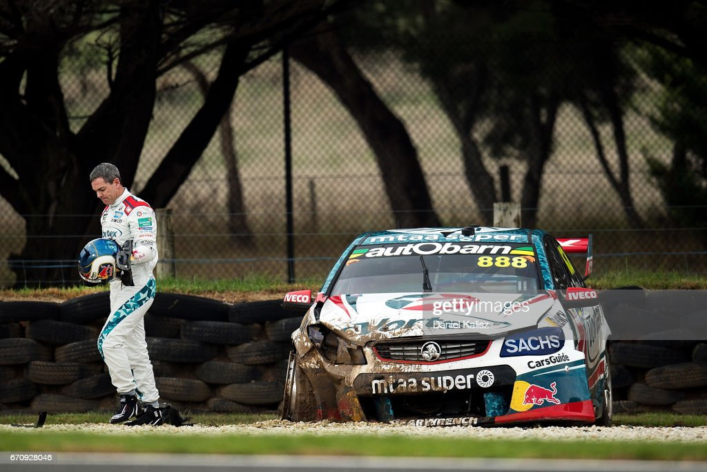 Craig Lowndes driver of the #888 TeamVortex Holden Commodore VF walks from his car after crashing during practice ahead of the Phillip Island 500, which is part of the Supercars Championship at Phillip Island Grand Prix Circuit on April 21, 2017 in Phillip Island, Australia.