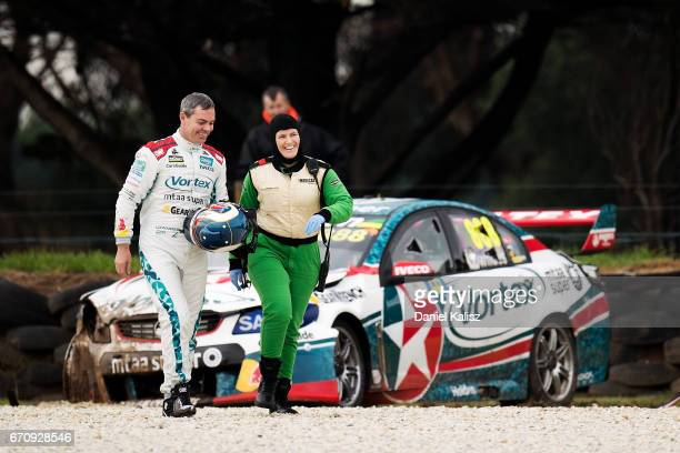 Craig Lowndes driver of the TeamVortex Holden Commodore VF walks from his car after crashing during practice ahead of the Phillip Island 500 which is...