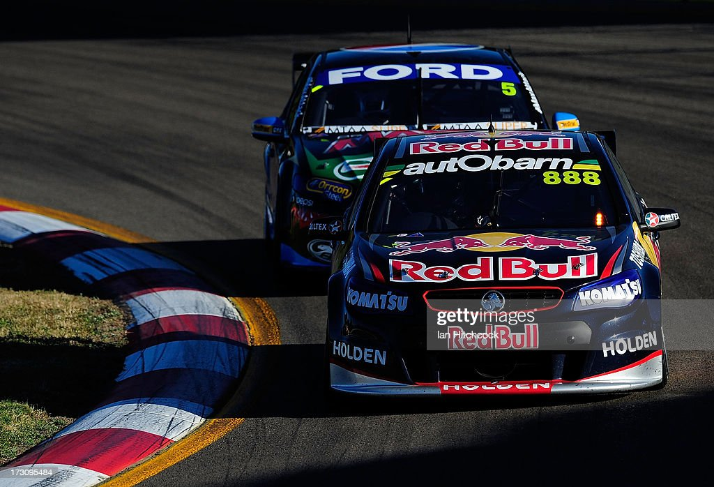 <a gi-track='captionPersonalityLinkClicked' href=/galleries/search?phrase=Craig+Lowndes&family=editorial&specificpeople=213462 ng-click='$event.stopPropagation()'>Craig Lowndes</a> drives the #888 Red Bull Racing Australia Holden during race 21 of the Townsville 400, which is round seven of the V8 Supercar Championship Series at Reid Park on July 7, 2013 in Townsville, Australia.