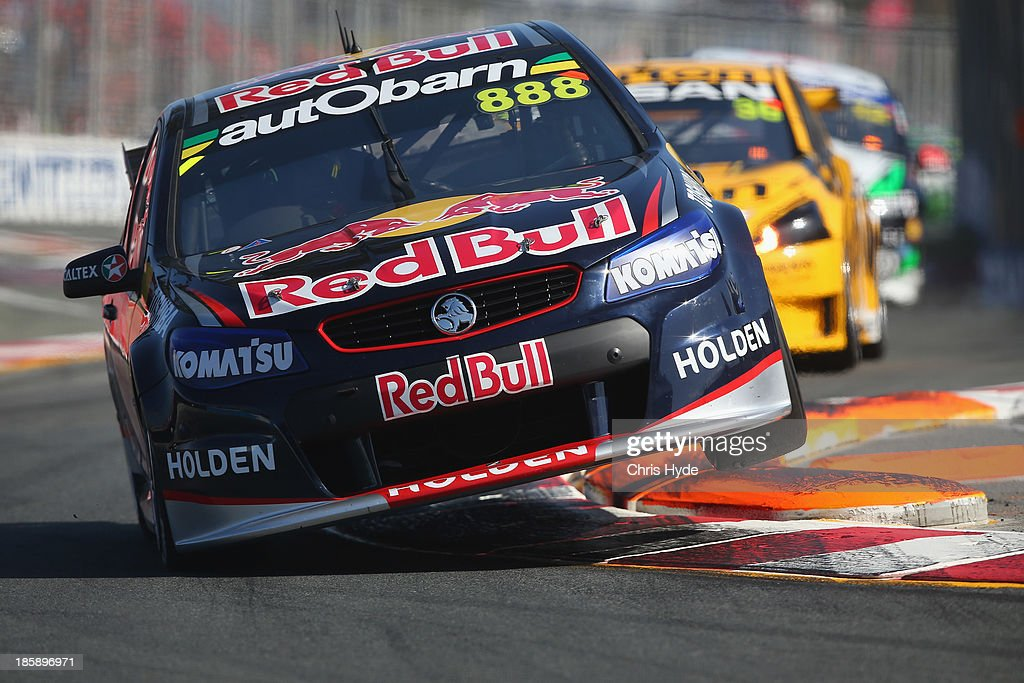 <a gi-track='captionPersonalityLinkClicked' href=/galleries/search?phrase=Craig+Lowndes&family=editorial&specificpeople=213462 ng-click='$event.stopPropagation()'>Craig Lowndes</a> drives the #888 Red Bull Racing Australia Holden during race 30 for the Gold Coast 600, which is round 12 of the V8 Supercars Championship Series at the Surfers Paradise Street Circuit on October 26, 2013 on the Gold Coast, Australia.
