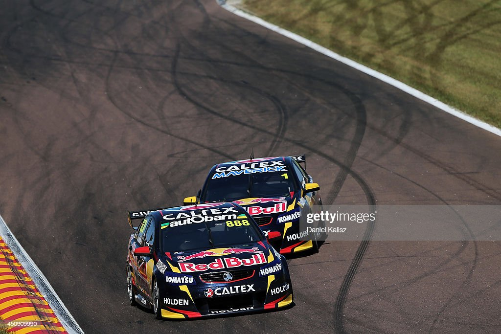 <a gi-track='captionPersonalityLinkClicked' href=/galleries/search?phrase=Craig+Lowndes&family=editorial&specificpeople=213462 ng-click='$event.stopPropagation()'>Craig Lowndes</a> drives the #888 Red Bull Racing Australia Holden leads <a gi-track='captionPersonalityLinkClicked' href=/galleries/search?phrase=Jamie+Whincup&family=editorial&specificpeople=678654 ng-click='$event.stopPropagation()'>Jamie Whincup</a> drives the #1 Red Bull Racing Australia Holden during practice for the Triple Crown Darwin, which is round six of the V8 Supercar Championship Series at Hidden Valley Raceway on June 20, 2014 in Darwin, Australia.
