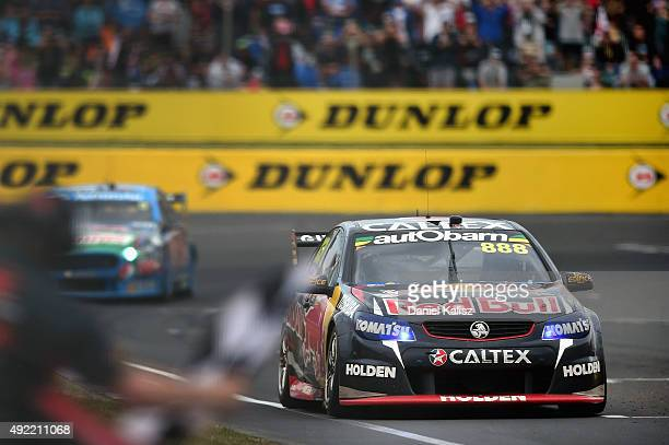 Craig Lowndes drives the Red Bull Racing Holden VF Commodore takes the chequered flag to win the Bathurst 1000 which is race 25 of the V8 Supercars...