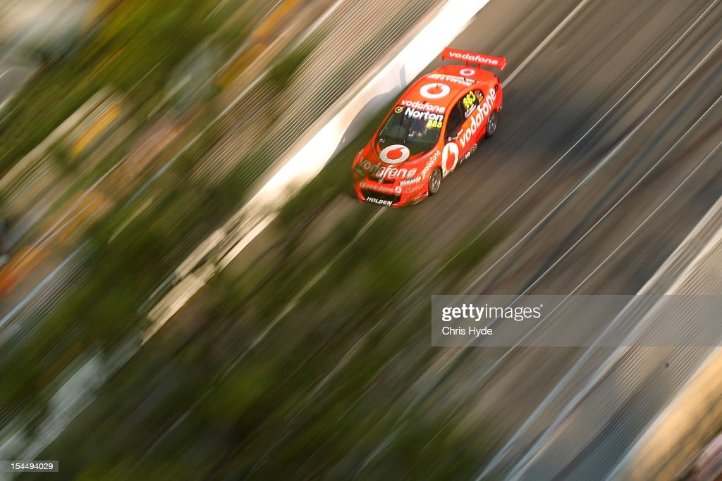 <a gi-track='captionPersonalityLinkClicked' href=/galleries/search?phrase=Craig+Lowndes&family=editorial&specificpeople=213462 ng-click='$event.stopPropagation()'>Craig Lowndes</a> drives the #888 Team Vodafone Holden during race 23 of the Gold Coast 600, which is round 12 of the V8 Supercars Championship Series at the Gold Coast Street Circuit on October 21, 2012 on the Gold Coast, Australia.