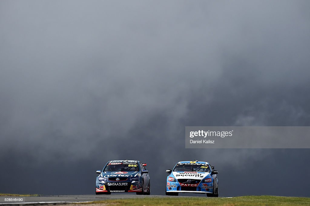 Craig Lowndes drives the TeamVortex Holden Commodore VF and Scott McLaughlin drives the Wilson Security Racing GRM Volvo S60 during practice for the...