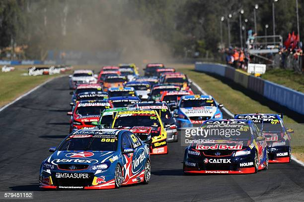 Craig Lowndes drives the TeamVortex Holden Commodore VF leads the field at the start of race 2 for the V8 Supercars Ipswich Supersprint on July 24...