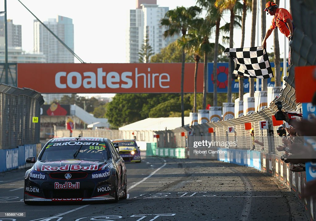 Craig Lowndes driving the #888 Red Bull Racing Australia Holden crosses the line to win race 30 for the Gold Coast 600, which is round 12 of the V8 Supercars Championship Series at the Surfers Paradise Street Circuit on October 26, 2013 on the Gold Coast, Australia.