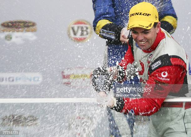 Craig Lowndes of Team Vodafone celebrates victory after the Bathurst 1000 which is round 10 of the V8 Supercar Championship Series at the Mount...