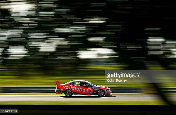Craig Lowndes of Team Vodafone drives during race one of round five of the V8 Supercars Championship Series at Sandown International Motor Raceway on...