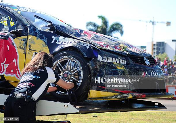 Craig Lowndes Red Bull Racing Australia Holden is pulled out of a tyre wall after crashing during race 20 for the Townsville 500 which is round seven...