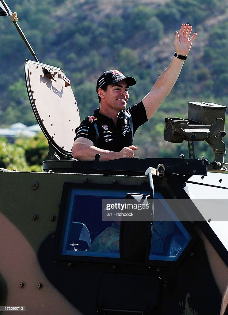 Craig Lowndes who drives the #888 Red Bull Racing Australia Holden waves to the crowd from an Australian Army Bushmaster amoured vehicle during the drivers parade before race 21 of the Townsville 400, which is round seven of the V8 Supercar Championship Series at Reid Park on July 7, 2013 in Townsville, Australia.