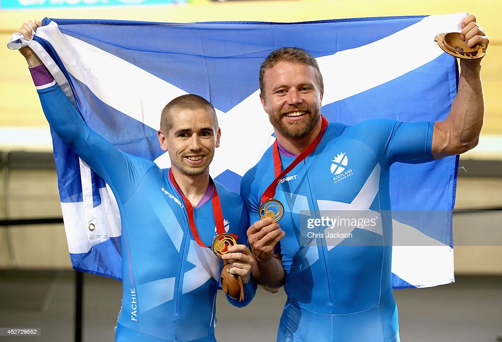 <a gi-track='captionPersonalityLinkClicked' href=/galleries/search?phrase=Craig+MacLean&family=editorial&specificpeople=684947 ng-click='$event.stopPropagation()'>Craig MacLean</a> and <a gi-track='captionPersonalityLinkClicked' href=/galleries/search?phrase=Neil+Fachie&family=editorial&specificpeople=4820369 ng-click='$event.stopPropagation()'>Neil Fachie</a> of Scotland pose with their Gold Medals after winning in the Para Sprint at the Sir Chris Hoy Velodrome during the Commonwealth games on July 26, 2014 in Glasgow, Scotland.
