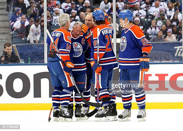 Craig MacTavish BJ MacDonald Dave Semenko Mike Krushelnyski and Craig Muni of the Edmonton Oilers alumni celebrate a third period goal against the...